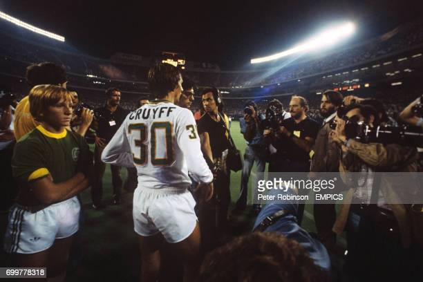 Johan Cruyff of New York Cosmos is surrounded by media attention