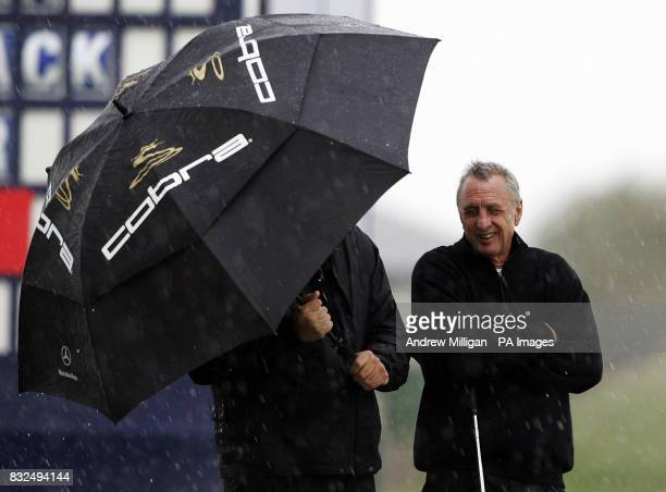 Johan Cruyff shelters from the rain during the Dunhill Links Championship at Kingsbarns Golf Course Fife