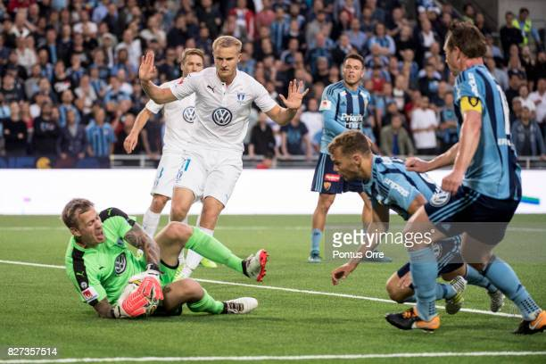 Johan Dahlin goalkeeper of Malmo FF makes a save Franz Brorsson watching the situation during the Allsvenskan match between Djurgardens IF and Malmo...