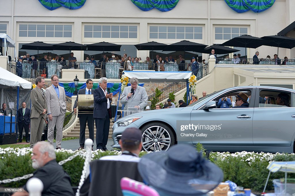 Johan de Nysschen, President of Infiniti Motor Company Limited (2nd L), TV personality Jay Leno (4th L), actor <a gi-track='captionPersonalityLinkClicked' href=/galleries/search?phrase=Edward+Herrmann+-+Actor&family=editorial&specificpeople=11698319 ng-click='$event.stopPropagation()'>Edward Herrmann</a> (3rd R) and Kyle Bazemore, Senior Manager, Product Communications, Infiniti (2nd R), present an Infiniti Q50 to the winner of the Boys & Girls Clubs of America charity raffle on August 18, 2013 in Pebble Beach, California.