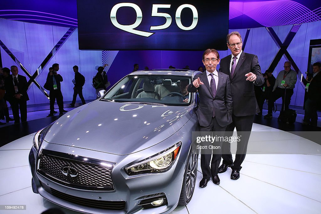 Johan De Nysschen (R) president of Infiniti Motor Corp. and Shiro Nakamura chief creative offcer, introduce the 2014 Q50 to replace their best-selling G sedan at the North American International Auto Show on January 14, 2013 in Detroit, Michigan. The auto show will be open to the public January 19-27.