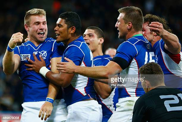 Johan Deysel of Namibia celebrates his teams opening try during the 2015 Rugby World Cup Pool C match between New Zealand and Namibia at the Olympic...