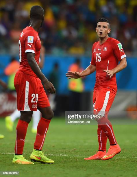 Johan Djourou and Blerim Dzemaili of Switzerland react during the 2014 FIFA World Cup Brazil Group E match between Switzerland and France at Arena...