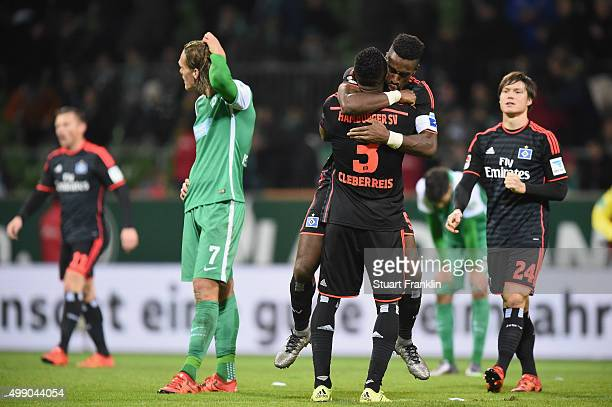 Johan Djourou and Cleber Reis of Hamburg celebrate at the end of the Bundesliga match between Werder Bremen and Hamburger SV at Weserstadion on...