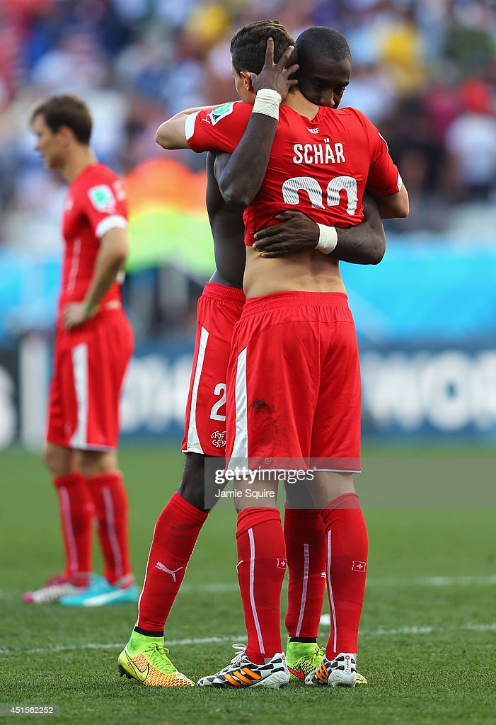 <a gi-track='captionPersonalityLinkClicked' href=/galleries/search?phrase=Johan+Djourou&family=editorial&specificpeople=534997 ng-click='$event.stopPropagation()'>Johan Djourou</a> and Fabian Schar of Switzerland react after being defeated by Argentina 1-0 in extra time during the 2014 FIFA World Cup Brazil Round of 16 match between Argentina and Switzerland at Arena de Sao Paulo on July 1, 2014 in Sao Paulo, Brazil.