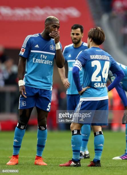 Johan Djourou and Gotoku Sakai of Hamburg look dejected after the Bundesliga match between Bayern Muenchen and Hamburger SV at Allianz Arena on...