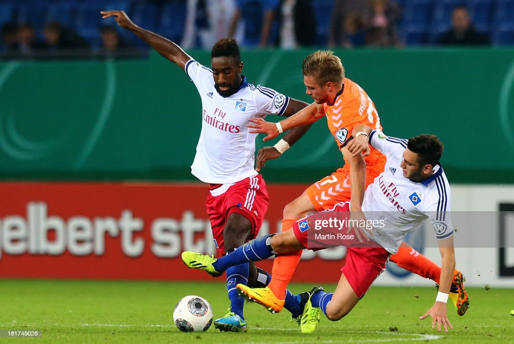 <a gi-track='captionPersonalityLinkClicked' href=/galleries/search?phrase=Johan+Djourou&family=editorial&specificpeople=534997 ng-click='$event.stopPropagation()'>Johan Djourou</a> (L) and Hakan Calhanoglu (R) of Hamburg and <a gi-track='captionPersonalityLinkClicked' href=/galleries/search?phrase=Florian+Trinks&family=editorial&specificpeople=5528640 ng-click='$event.stopPropagation()'>Florian Trinks</a> (C) of Greuther Fuerth battle for the ball during the DFB Cup second round match between Hamburger SV and Greuther Fuerth at Imtech Arena on September 24, 2013 in Hamburg, Germany.