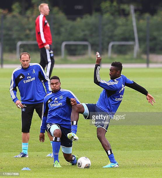 Johan Djourou new player of Hamburger SV battles for the ball with Jonathan Tah during the training session of Hamburger SV at the club's training...