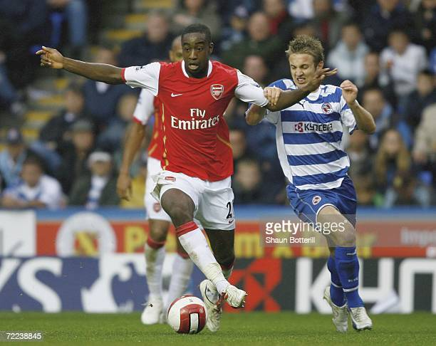 Johan Djourou of Arsenal holds off a challenge from Kevin Doyle of Reading during the Barclays Premiership match between Reading and Arsenal at the...