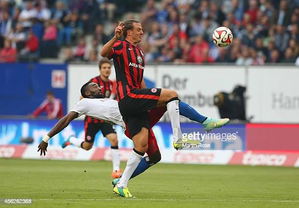 Johan Djourou of Hamburg and Alex Meier of Frankfurt battle for the ball during the Bundesliga match between Hamburger SV and Eintracht Frankfurt at...