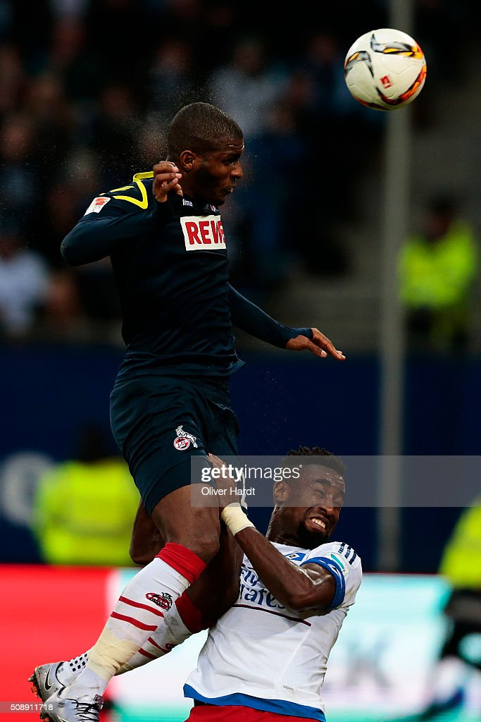 <a gi-track='captionPersonalityLinkClicked' href=/galleries/search?phrase=Johan+Djourou&family=editorial&specificpeople=534997 ng-click='$event.stopPropagation()'>Johan Djourou</a> (R) of Hamburg and Anthony Modeste (C) of Koeln compete for the ball during the First Bundesliga match between Hamburger SV and 1. FC Koeln at Volksparkstadion on February 7, 2016 in Hamburg, Germany.