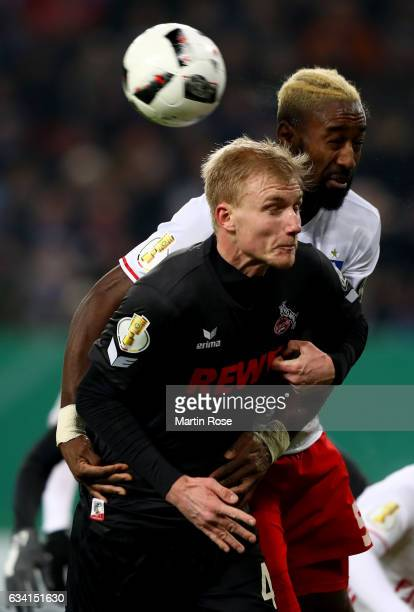 Johan Djourou of Hamburg and Dominique Klein of Koeln head for the ball during the DFB Cup round of 16 match between Hamburger SV and 1 FC Koeln at...