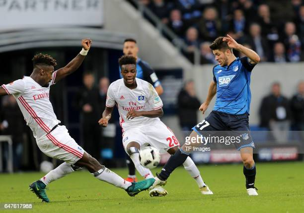 Johan Djourou of Hamburg and Gideon Jung of Hamburg and Andrej Kramaric of Hoffenheim battle for the ball during the Bundesliga match between TSG...