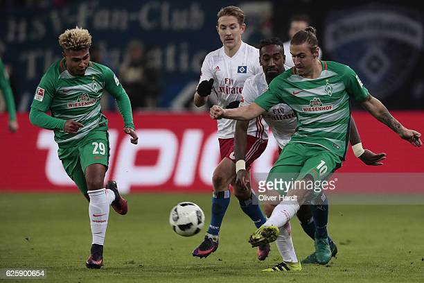 Johan Djourou of Hamburg and Max Kruse of Bremen compete for the ball during the Bundesliga match between Hamburger SV and Werder Bremen at...