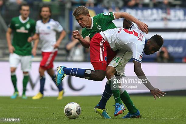 Johan Djourou of Hamburg challenges Nils Petersen of Bremen during the Bundesliga match between Hamburger SV and Werder Bremen at Imtech Arena on...