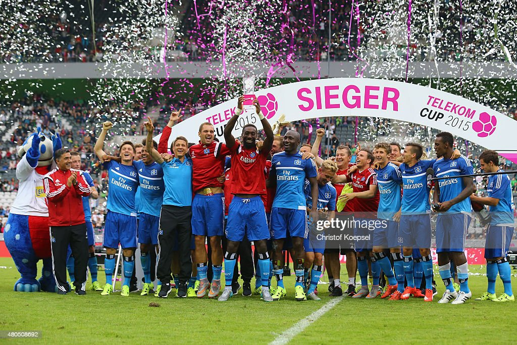 Johan Djourou of Hamburg lifts the winning trophy after winning 2-1 the Telekom Cup 2015 final match between Hambruger SV and FC Augsburg at Borussia-Park on July 12, 2015 in Moenchengladbach, Germany.