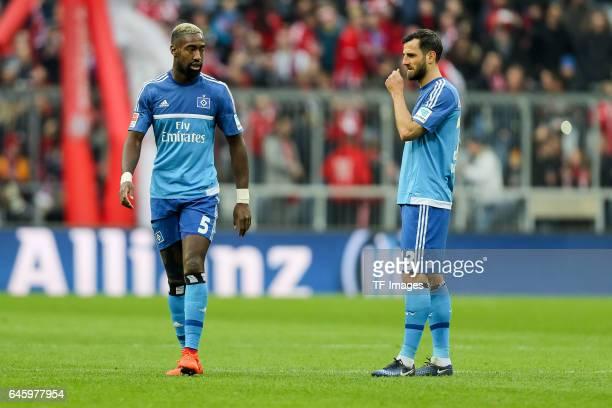 Johan Djourou of Hamburg Mergim Mavraj of Hamburg looks dejected during the Bundesliga match between Bayern Muenchen and Hamburger SV at Allianz...