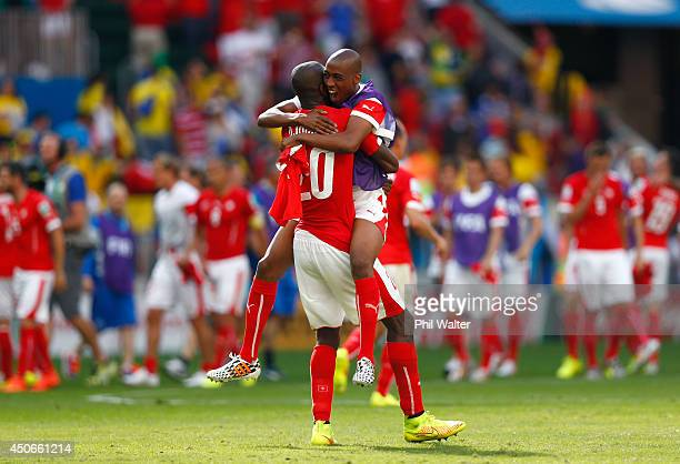 Johan Djourou of Switzerland is hugged by teammate Gelson Fernandes after defeating Ecuador 21 during the 2014 FIFA World Cup Brazil Group E match...