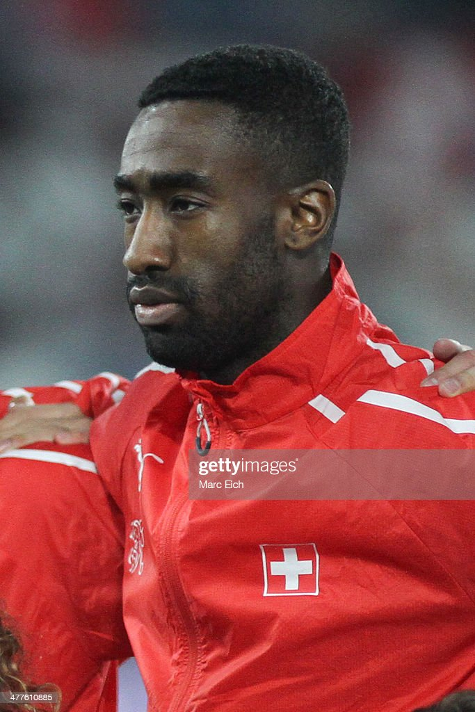 <a gi-track='captionPersonalityLinkClicked' href=/galleries/search?phrase=Johan+Djourou&family=editorial&specificpeople=534997 ng-click='$event.stopPropagation()'>Johan Djourou</a> of Switzerland stands for the national anthem prior the international friendly match between Switzerland and Croatia at the AFG Arena on March 5, 2014 in St Gallen, Switzerland.