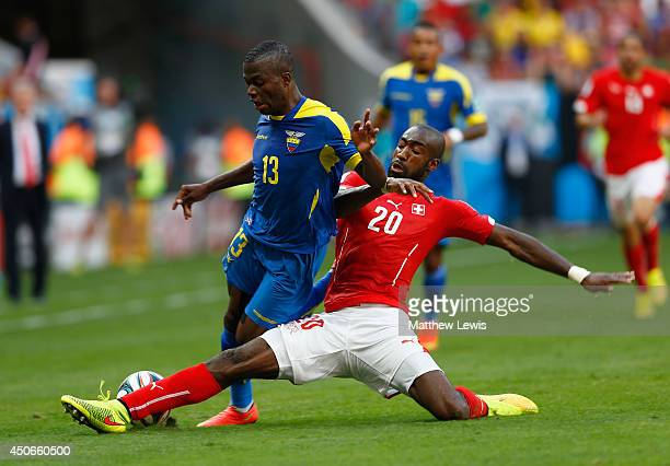 Johan Djourou of Switzerland tackles Enner Valencia of Ecuador during the 2014 FIFA World Cup Brazil Group E match between Switzerland and Ecuador at...