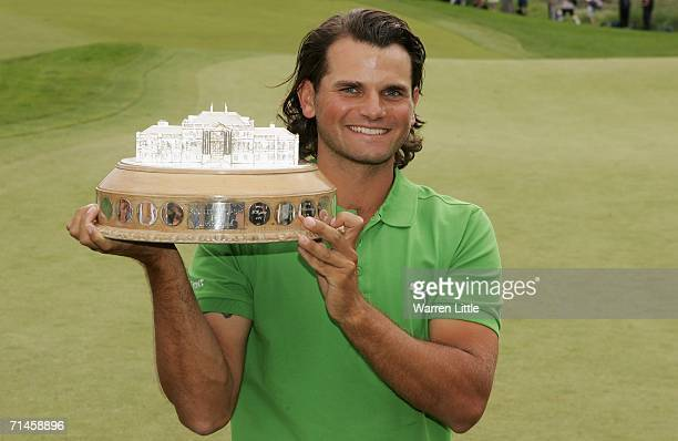 Johan Edfors of Sweden poses with the trophy following his victory after the final round of The Barclays Scottish Open at Loch Lomond Golf Club on...