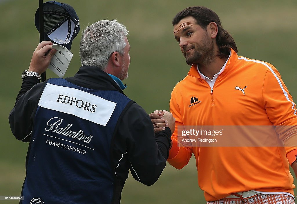Johan Edfors of Sweden shakes hands with his caddie Brian Martin on the 18th hole during the first round of the Ballantine's Championship at Blackstone Golf Club on April 25, 2013 in Icheon, South Korea.