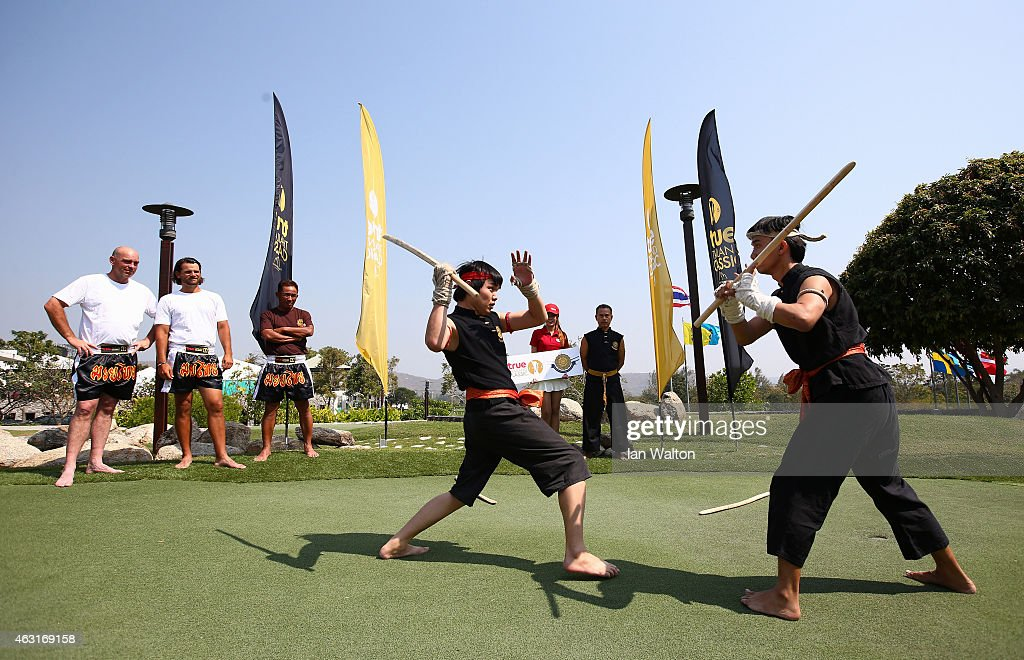Johan Edfors of Sweden Thomas Bjorn of Denmark and Thongchai Jaidee of Thailand look on at a Muay Thai event during the proam of the 2015 True...