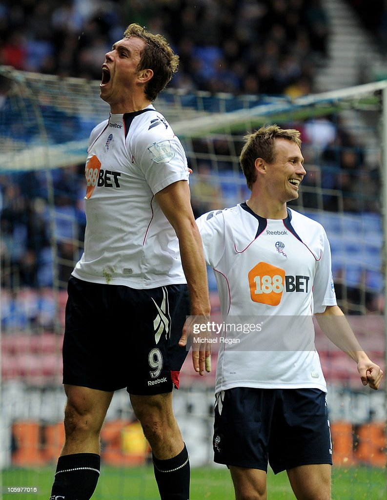 <a gi-track='captionPersonalityLinkClicked' href=/galleries/search?phrase=Johan+Elmander&family=editorial&specificpeople=553763 ng-click='$event.stopPropagation()'>Johan Elmander</a> of Bolton Wanderers celebrates scoring his team's first goal with team mate Matt Taylor (R) during the Barclays Premier League match between Wigan Athletic and Bolton Wanderers at the DW Stadium on October 23, 2010 in Wigan, England.