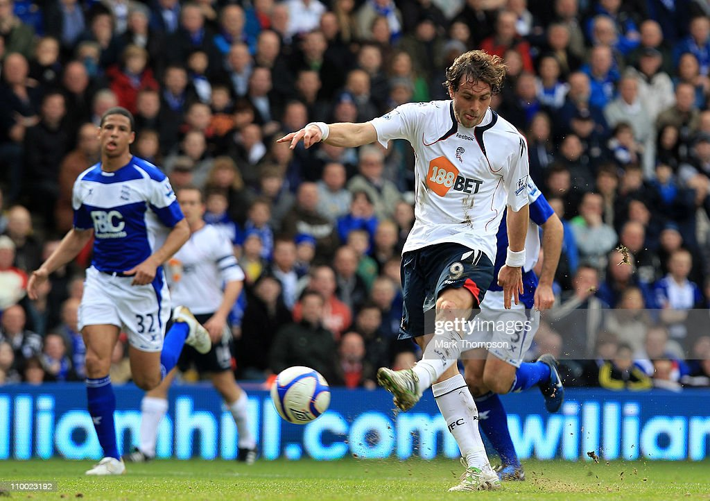 <a gi-track='captionPersonalityLinkClicked' href=/galleries/search?phrase=Johan+Elmander&family=editorial&specificpeople=553763 ng-click='$event.stopPropagation()'>Johan Elmander</a> of Bolton Wanderers scores the opening goal during the FA Cup sponsored by E.On Sixth Round match between Birmingham City and Bolton Wanderers at St Andrews on March 12, 2011 in Birmingham, England.