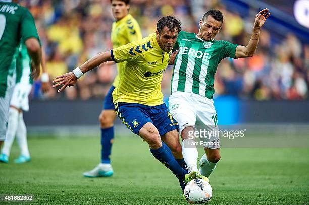 Johan Elmander of Brondby IF and Atanas Zehirov of PFC Beroe Stara Zagora compete for the ball during the UEFA Europa League Qualification match...