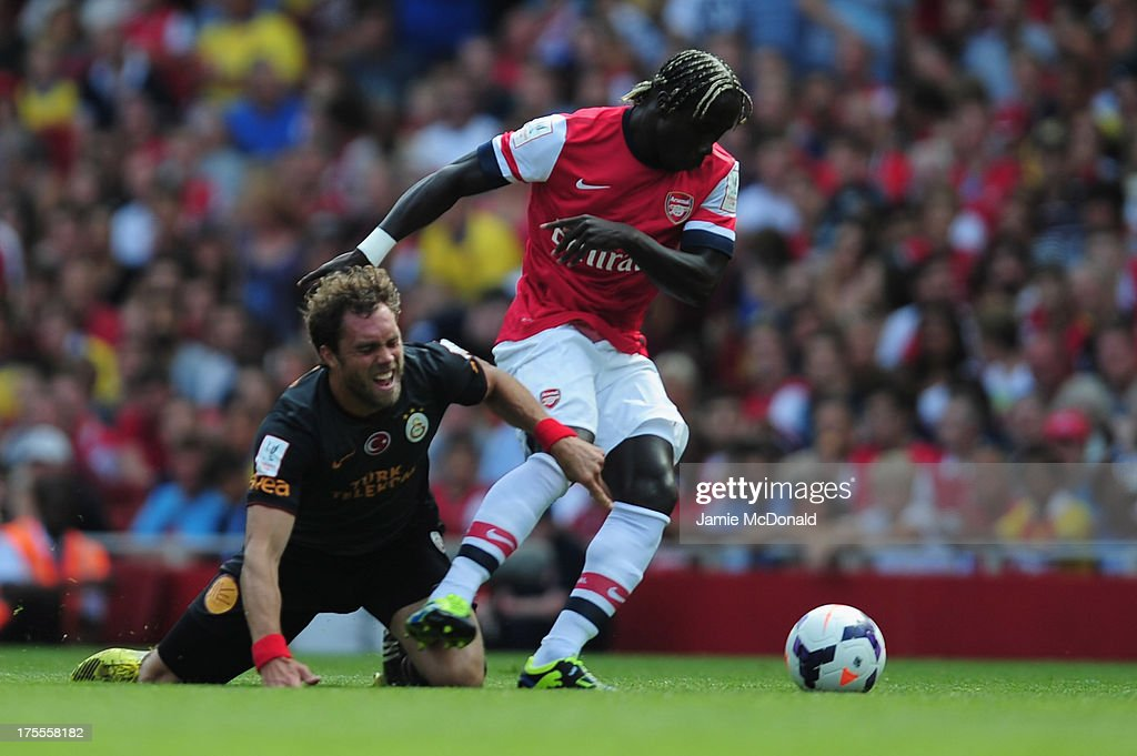 Johan Elmander of Galatasaray battles with Bacary Sagna of Arsenal during the Emirates Cup match between Arsenal and Galatasaray at the Emirates Stadium on August 4, 2013 in London, England.