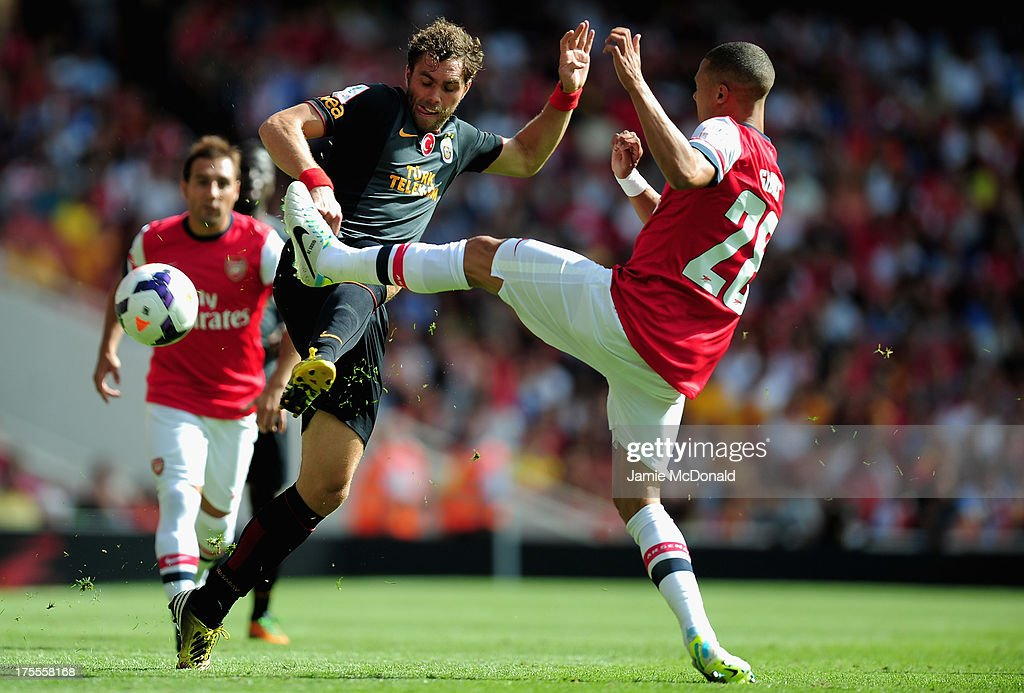 Johan Elmander of Galatasaray battles with Kieran Gibbs of Arsenal during the Emirates Cup match between Arsenal and Galatasaray at the Emirates Stadium on August 4, 2013 in London, England.