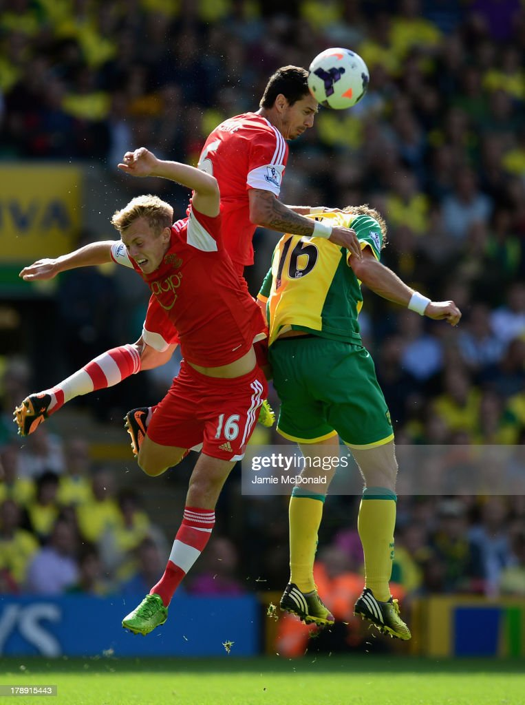 <a gi-track='captionPersonalityLinkClicked' href=/galleries/search?phrase=Johan+Elmander&family=editorial&specificpeople=553763 ng-click='$event.stopPropagation()'>Johan Elmander</a> of Norwich City battles with Jose Fonte and James Ward-Prowse of Southampton during the Barclays Premier League match between Norwich City and Southampton at Carrow Road on August 31, 2013 in Norwich, England.