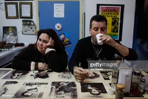 Johan Espino and Omar Santos drink their coffees at Red House Cafe February 29 2008 in Miami Florida Today the price of coffee hit its highest level...