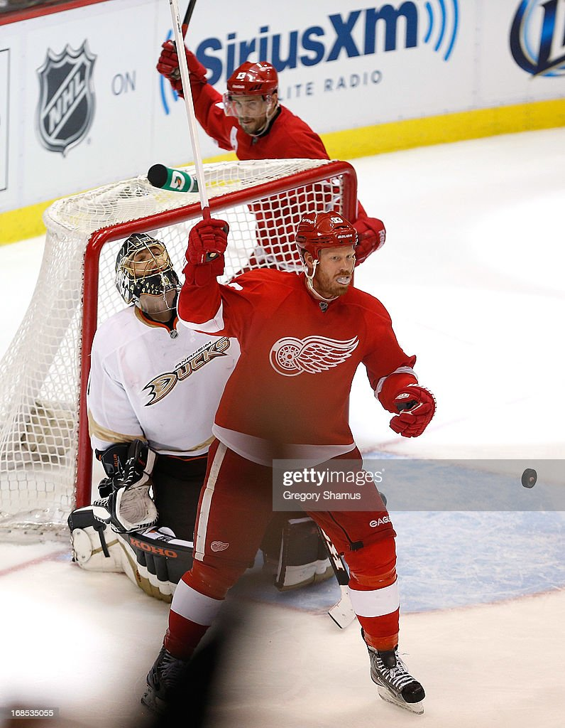 Johan Franzen #93 and Pavel Datsyuk #13 of the Detroit Red Wings react to a goal by teammate Henrik Zetterberg #40 (not pictured) with Jonas Hiller #1 of the Anaheim Ducks looking on in Game Six of the Western Conference Quarterfinals during the 2013 NHL Stanley Cup Playoffs at Joe Louis Arena on May 10, 2013 in Detroit, Michigan. Detroit won the game in overtime 4-3 to tie the series 3-3.