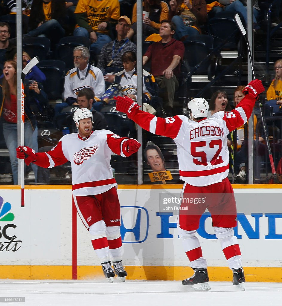 Johan Franzen #93 celebrates his goal with Jonathan Ericsson #52 of the Detroit Red Wings against the Nashville Predators during an NHL game at the Bridgestone Arena on April 14, 2013 in Nashville, Tennessee.