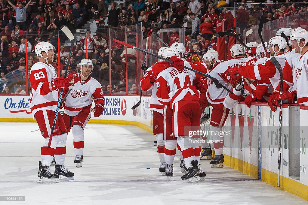 Johan Franzen Jakub Kindl and Gustav Nyquist of the Detroit Red Wings celebrate their overtime win over the Ottawa Senators at Canadian Tire Centre...