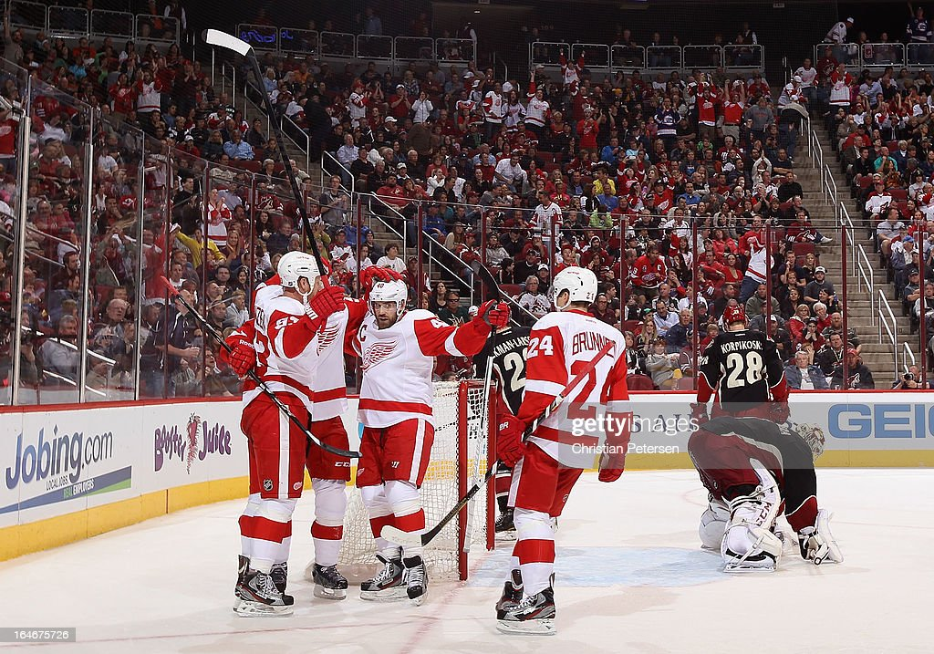 Johan Franzen #93, Niklas Kronwall #55, Henrik Zetterberg #40 and Damien Brunner #24 of the Detroit Red Wings celebrate after Franzen scored a second period goal past goaltender Jason LaBarbera #1 of the Phoenix Coyotes during the NHL game at Jobing.com Arena on March 25, 2013 in Glendale, Arizona.