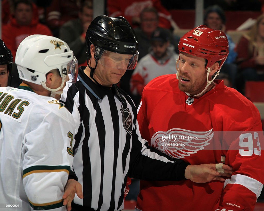 <a gi-track='captionPersonalityLinkClicked' href=/galleries/search?phrase=Johan+Franzen&family=editorial&specificpeople=624356 ng-click='$event.stopPropagation()'>Johan Franzen</a> #93 of the Detroit Red Wings and <a gi-track='captionPersonalityLinkClicked' href=/galleries/search?phrase=Stephane+Robidas&family=editorial&specificpeople=206166 ng-click='$event.stopPropagation()'>Stephane Robidas</a> #3 of the Dallas Stars exchange words during a NHL game at Joe Louis Arena on January 22, 2013 in Detroit, Michigan.
