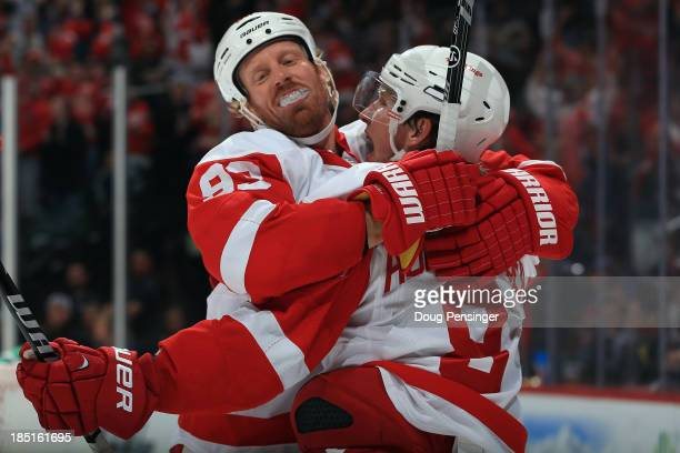 Johan Franzen of the Detroit Red Wings celebrates with Justin Abdelkader after Franzen scored the winning goal against the Colorado Avalanche in the...