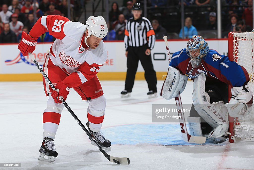 <a gi-track='captionPersonalityLinkClicked' href=/galleries/search?phrase=Johan+Franzen&family=editorial&specificpeople=624356 ng-click='$event.stopPropagation()'>Johan Franzen</a> #93 of the Detroit Red Wings controls the puck as he scores against goalie <a gi-track='captionPersonalityLinkClicked' href=/galleries/search?phrase=Semyon+Varlamov&family=editorial&specificpeople=6264893 ng-click='$event.stopPropagation()'>Semyon Varlamov</a> #1 of the Colorado Avalanche to take a 1-0 lead in the first period at Pepsi Center on October 17, 2013 in Denver, Colorado.