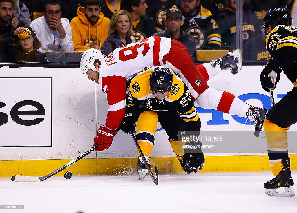 Johan Franzen of the Detroit Red Wings flips over Brad Marchand of the Boston Bruins in the first period during the game at TD Garden on April 20...