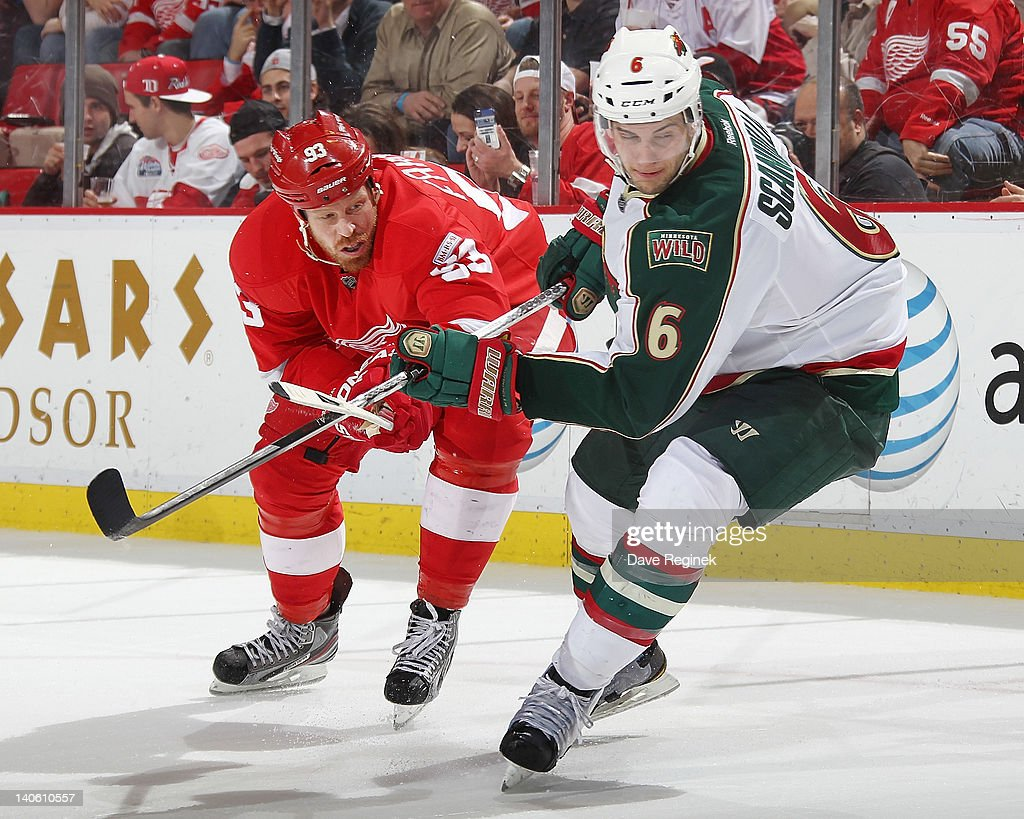 <a gi-track='captionPersonalityLinkClicked' href=/galleries/search?phrase=Johan+Franzen&family=editorial&specificpeople=624356 ng-click='$event.stopPropagation()'>Johan Franzen</a> #93 of the Detroit Red Wings looks to the play with Marco Scandella #6 of the Minnesota Wild during an NHL game at Joe Louis Arena on March 2, 2012 in Detroit, Michigan.