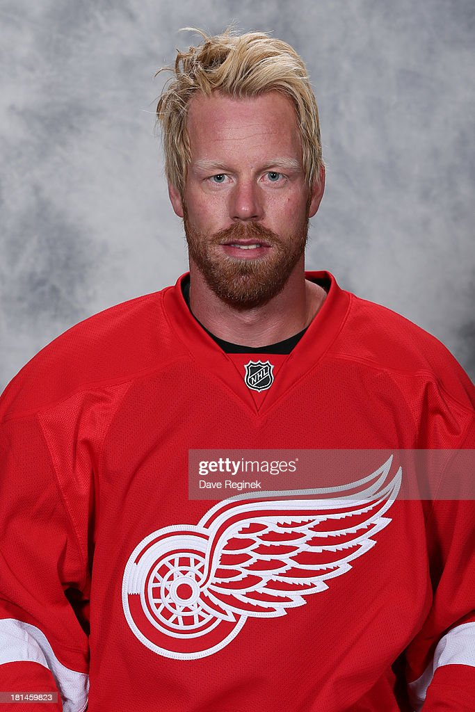 <a gi-track='captionPersonalityLinkClicked' href=/galleries/search?phrase=Johan+Franzen&family=editorial&specificpeople=624356 ng-click='$event.stopPropagation()'>Johan Franzen</a> #93 of the Detroit Red Wings poses for his official headshot for the 2013-2014 season at Centre Ice Arena on September 11, 2013 in Traverse City, Michigan.