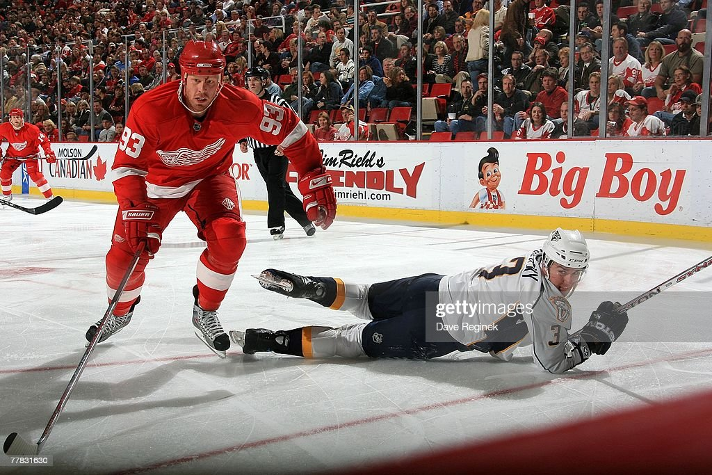 c87d3f930 ... Johan Franzen 93 of the Detroit Red Wings skates past the falling Marek  Zidlicky hockey ...