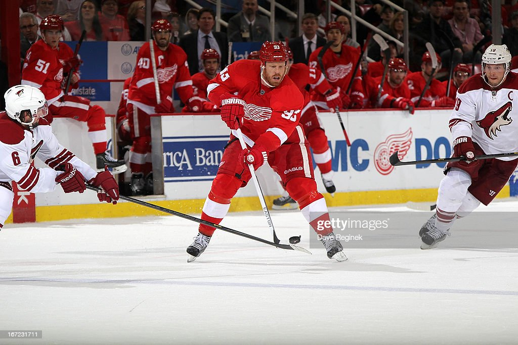 <a gi-track='captionPersonalityLinkClicked' href=/galleries/search?phrase=Johan+Franzen&family=editorial&specificpeople=624356 ng-click='$event.stopPropagation()'>Johan Franzen</a> #93 of the Detroit Red Wings skates with the puck between <a gi-track='captionPersonalityLinkClicked' href=/galleries/search?phrase=David+Schlemko&family=editorial&specificpeople=3144738 ng-click='$event.stopPropagation()'>David Schlemko</a> #6 and <a gi-track='captionPersonalityLinkClicked' href=/galleries/search?phrase=Shane+Doan&family=editorial&specificpeople=201614 ng-click='$event.stopPropagation()'>Shane Doan</a> #19 of the Phoenix Coyotes during a NHL game at Joe Louis Arena on April 22, 2013 in Detroit, Michigan. Detroit defeated Phoenix 4-0