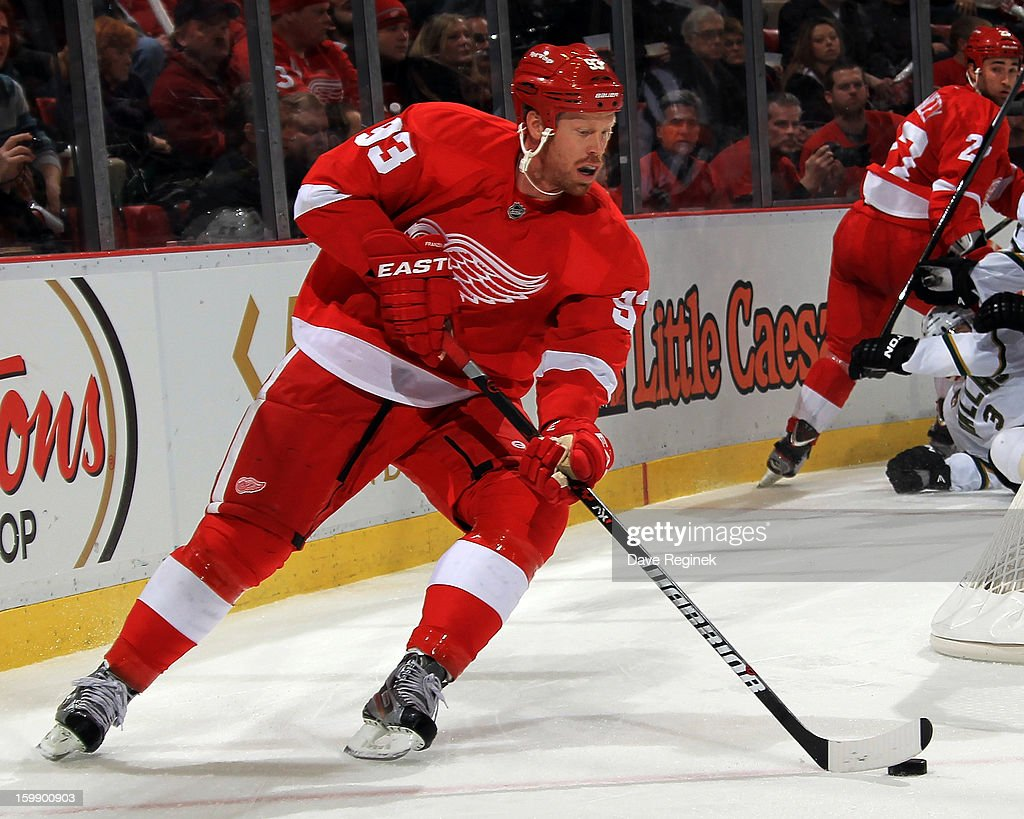 <a gi-track='captionPersonalityLinkClicked' href=/galleries/search?phrase=Johan+Franzen&family=editorial&specificpeople=624356 ng-click='$event.stopPropagation()'>Johan Franzen</a> #93 of the Detroit Red Wings skates with the puck during a NHL game against the Dallas Stars at Joe Louis Arena on January 22, 2013 in Detroit, Michigan.