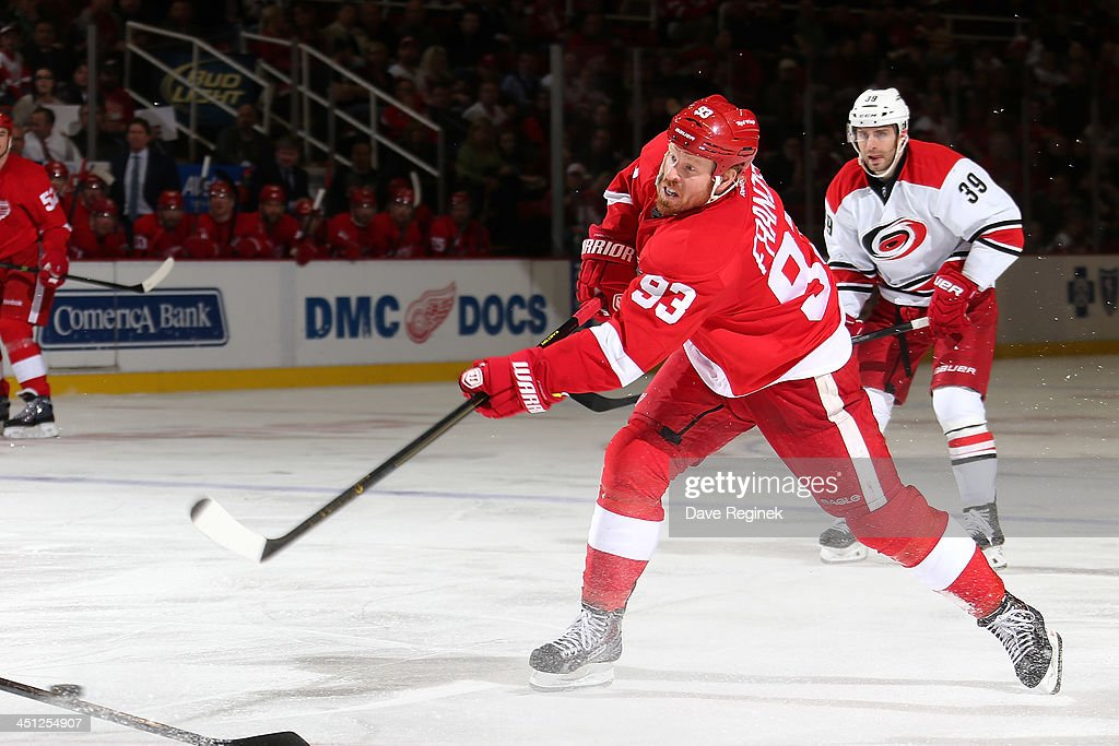 <a gi-track='captionPersonalityLinkClicked' href=/galleries/search?phrase=Johan+Franzen&family=editorial&specificpeople=624356 ng-click='$event.stopPropagation()'>Johan Franzen</a> #93 of the Detroit Red Wings takes a big slap shot during an NHL game against the Carolina Hurricanes at Joe Louis Arena on November 21, 2013 in Detroit, Michigan. Detroit defeated Carolina 4-3