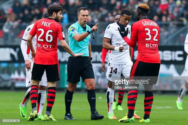 Johan Hamel referee with Joris Gnagnon of Rennes during the Ligue 1 match between Stade Rennais and OGC Nice at Roazhon Park on February 12 2017 in...