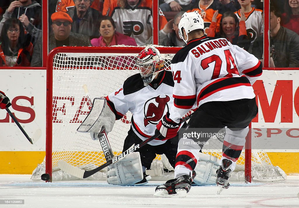 Johan Hedberg #1 and Bryce Salvador #24 of the New Jersey Devils stop a shot on goal by a member of the Philadelphia Flyers on March 15, 2013 at the Wells Fargo Center in Philadelphia, Pennsylvania.